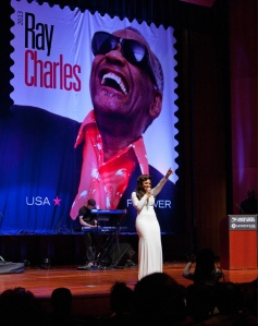 Recording Artist Ashanti performs at the Ray Charles stamp dedication ceremony at Morehouse College in Atlanta.